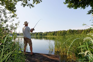 fisherman catching the fish durring sunny day