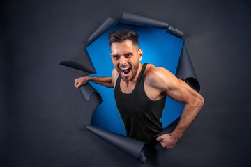 Handsome guy on a studio background