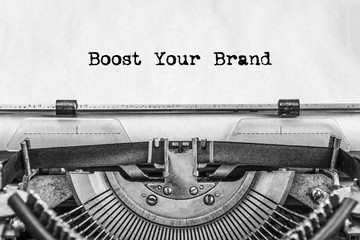Boost Your Brand text is typed not by a vintage typewriter, old paper, close-up