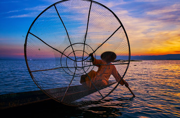 Posing with fishing net, Inle Lake, Myanmar
