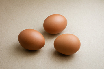 Brown chicken eggs on recycled craft paper