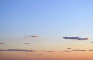 Rare clouds on the background of the sunset sky.