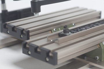 Engraving device pantograph with letterpress alphabet on a white background