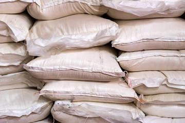 Many sugar bags stacked at modern winery