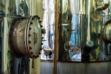 Chrome wine tanks at modern winery