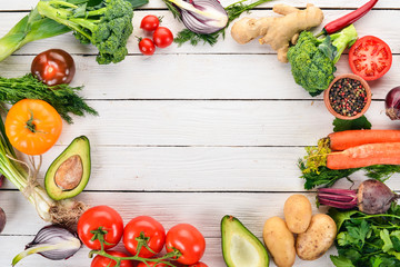 Healthy food. Vegetables and fruits. On a white wooden background. Top view. Copy space.