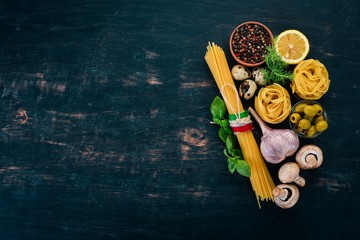 Preparation for paste preparation. Italian cuisine. On a wooden background. Top view. Copy space.