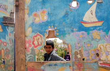 An Egyptian student is seen through door of Nile River school where young children are taught the basics of self-development through languages and various crafts in Al-Ayyat district southern of Cairo