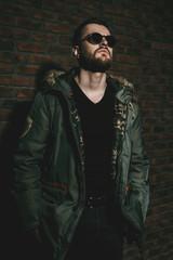 brutal man wearing jacket