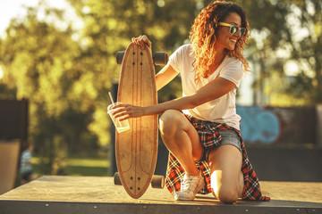 Female skater standing on ramp at the skate park.
