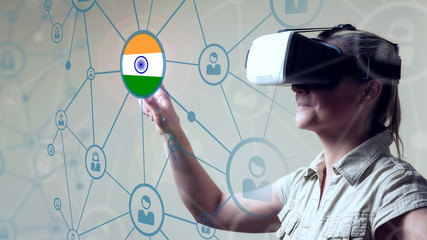 Young Woman looking through VR (Virtual Reality) glasses - Pointing Finger on screen Indian Flag