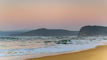 Hazy Reverse Sunrise Seascape with Paddleboarders