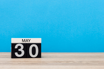 May 30th. Day 30 of may month, calendar on blue background. Spring time, empty space for text