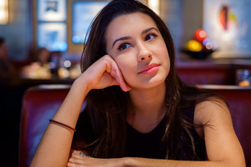 Beautiful young woman in a restaurant setting
