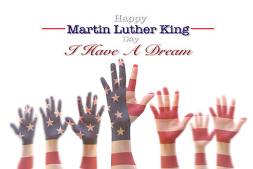 Martin Luther King day, January 18th, I have a dream with American flag pattern on people hands raising up