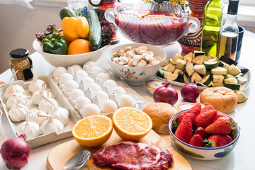 Raw food beef, egg with healthy food vegetables, fruits prepared cooking on the table