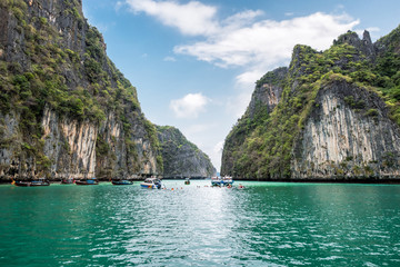 Pileh lagoon limestone mountain surrounded and emerald sea with tourists traveling at Krabi