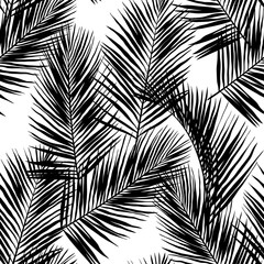 Black vector palm leaves isolated on white background. Hand drawn seamless pattern. Perfect for fabric, wallpaper or wrapping paper.
