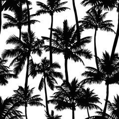 Black vector palm trees isolated on white background. Hand drawn seamless pattern. Perfect for fabric, wallpaper or wrapping paper.