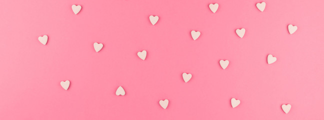 Flat lay of pink heart shaped candies