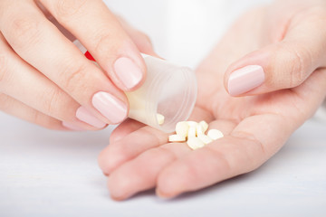 woman's hands with pills