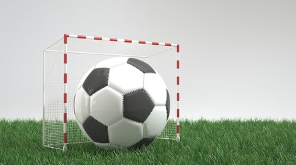 Ball in small football goal