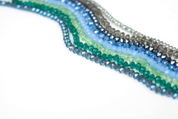 Colorful Shinny Crystal Beads Glass Isoalted on White Background Copy space for Text Fashion Beauty