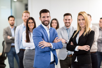 Portrait of business team posing in office