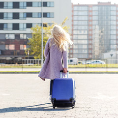 Young blonde woman going on vacation. Square. The concept of travel, wor