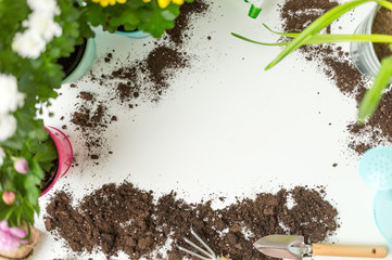 Photo of soil, watering can, flower pot, shovel, rake on empty white background.