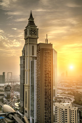 Fototapete - Downtown of Dubai city with skyscrapers at sunrise