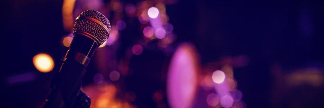 Microphone in illuminated nightclub