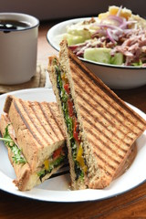 Healthy  panini sandwiches on wooden table