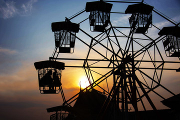 Silhouette Of Lover In The Ferris Wheel In The Evening.