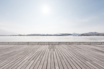 Panoramic skyline with empty concrete square floor