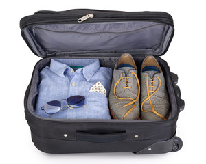 Man's suitcase packed for a short vacation or citytrip