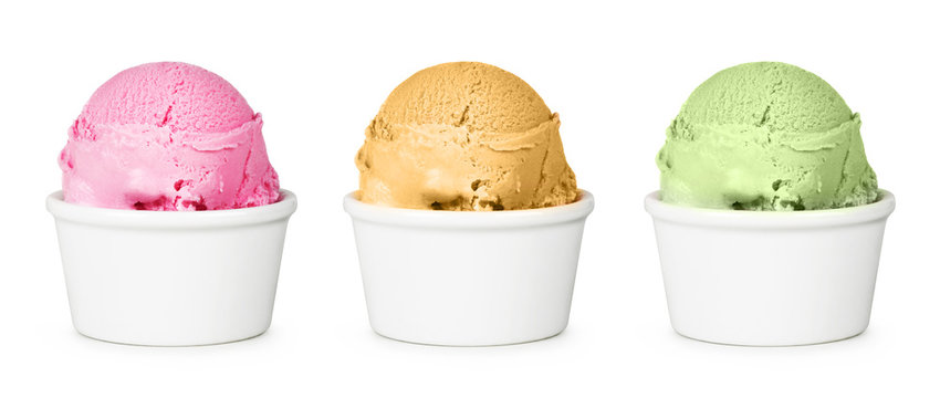 Different flavors of ice cream in the cup. Isolated on white background. Strawberry, peach and pistachio ice cream.