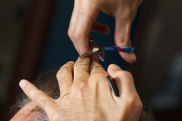 Male client getting haircut by hairdresser. barbershop