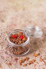 Chocolate granola in the jar, healthy breakfast