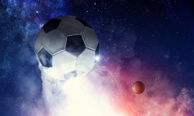 Wall Mural - Soccer ball in cosmos