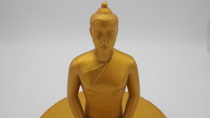 Buddha statue golden white back ground
