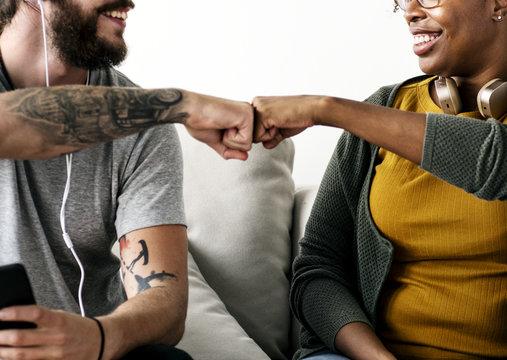 Musician couple fist bumping