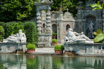 Aluminium Prints Historic monument Marlia, Lucca, Italy - 2018, May 25: The Villa Reale Lemon garden with large ornamental pool and stone balustrade; two statues of Giants representing the local rivers Arno and Serchio.