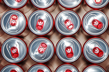 Metal cans with cooling drinks on a white background