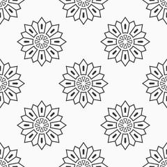 Abstract seamless monochrome floral mandala pattern.