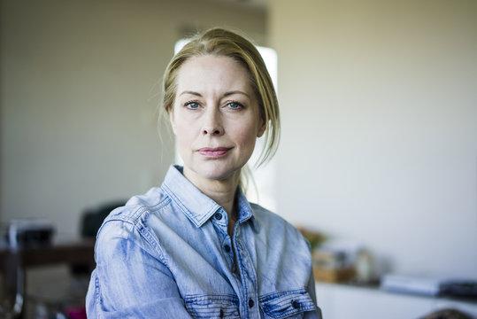 Portrait of blond businesswoman wearing denim shirt