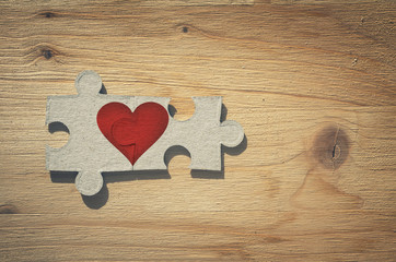 Two pieces of a puzzle with heart. Love is a thing of two concept.