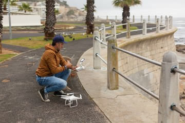 Man operating a flying drone