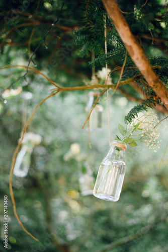 Beautiful wedding floral decoration of white roses flowers in mini beautiful wedding floral decoration of white roses flowers in mini vases hanging in the branches mightylinksfo