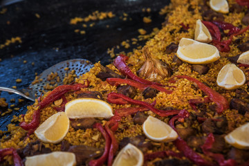 Typical spanish paella in the big traditional pan. Close view. Selective focus1